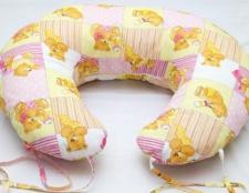 Як використовувати подушку для годування