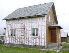 Як обшити дерев'яний будинок