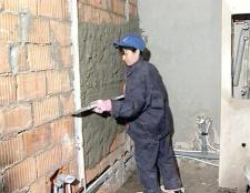 Як обштукатурити цегляні стіни