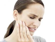 Як зняти зубний біль народними засобами