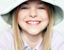 Як відрізнити корінний зуб від молочного